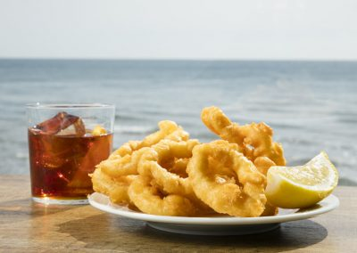 "Vermouth and fried squid ""a la romana"""